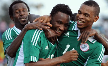 Super Eagles midfielder, Mikel Obi being mobbed by his team mates