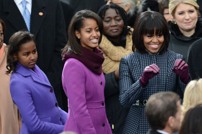 US Frist Lady Michelle Obama arrives with daughters Sasha (L) and Malia for the 57th Presidential Inauguration on January 21, 2013. US President Barack Obama will be ceremonially sworn in for a second term. AFP