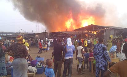 File photo: Victims of Oko Baba watching haplessly as fire destroys their abode