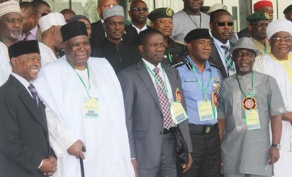 Representative of the President and Minister of Police Affairs, Navy Capt. Caleb Olubolade, rtd, (3rdl)flanked by the Chairman of the event, Alhaji Gambo Jimeta (2ndl) and the Inspector Genral of Police, Alhaji Mohammed Abubakar, while the Interior Minister, Comrade Abba Moro (2ndr); Publisher Vanguard, Mr. Sam Amuka (l) and other dignitaries at the official opening of the National Summit on Security Challenges in Nigeria held at the ICC, Abuja. Photo: Abayomi Adeshida