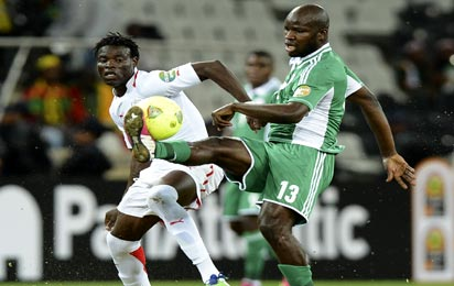 Nigeria's midfielder Fegor Ogude (R) vies with Burkina Faso's Ahmed Musa during the Afcon's Nigeria vs Burkina Faso group C match  AFP PHOTO
