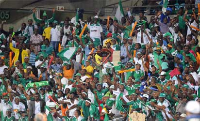 Nigeria supporters celebrate their team's  2-0 win over Ethiopia on January 29, 2013 after a 2013 African Cup of Nations Group C football match at the Royal Bafokeng stadium in Rustenburg. AFP PHOTO