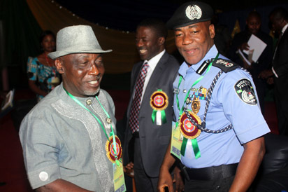 Represententative of the Presient, Navy Capt. Caleb Olubolade flanked by the Interior Minister, Comrade Abba Moro (left) and the Inspector General of Police, Alhaji Mohammed Abubakar at the opening of the National Summit on Security Challenges in Nigeria held at the African Hall, International Conference Centre, Abuja, Tuesday. Photo: Abayomi Adeshida.