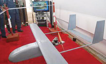 An unmanned aerial vehicle designed and built at the Air Force Institute of Technology on display during the event.