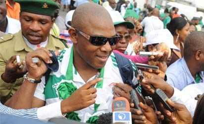 Coach of the Nigerian football team Stephen Keshi speaks to journalists at the airport in Abuja on February 12, 2013. The newly crowned African champions Nigerian Super Eagles arrives in Abuja to a warm reception by fans and government officials after defeating Burkina Faso to win the 2013 African Cup of Nations in South Africa. AFP PHOTO