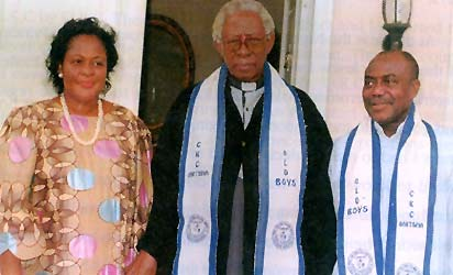 Rev. Fr. N. C. Tagbo, former principal of CKC Onitsha with Dr. and Mrs. Peter Odili