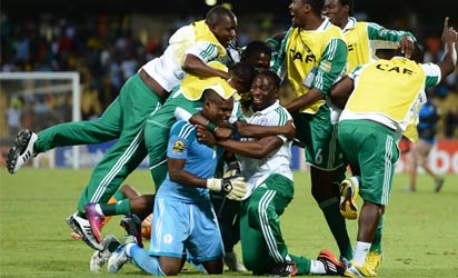 Nigeria's players celebrate at the end of the African Cup of Nation 2013 quarter final football match Ivory Coast vs Nigeria, on February 3, 2013 in Rustenburg. Nigeria won 2-1. AFP PHOTO