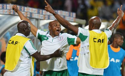 Nigeria's head coach Stephen Keshi (C) celebrates at the end of the African Cup of Nation 2013 quarter final football match Ivory Coast vs Nigeria, on February 3, 2013 in Rustenburg. Nigeria won 2-1. AFP PHOTO