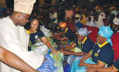 Mr. Amosun with 1,000 needy, aged men and women