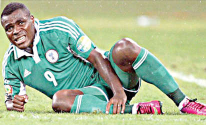 IN PAINS … Super Eagles striker, Emmanuel Emenike writhing in pains after he got knocked in the semi final match against Mali at the Africa Nations Cup in South Africa last month. He has lambasted both the NFF and Coach Stephen Keshi for not asking after his state of health since after the Nations Cup.