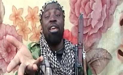 A video grab made on March 21, 2013 from a video distributed to reporters by purported intermediaries of the Islamist group linked to Al-Qaeda, Boko Haram,  shows the suspected leader of the Nigerian Islamist group linked to Al-Qaeda, Boko Haram, Imam Abu Muhammad Ibn Muhammad Abubakar Ash Shekawi, also known as Abubakar Shekau, at an undisclosed location in Nigeria. AFP