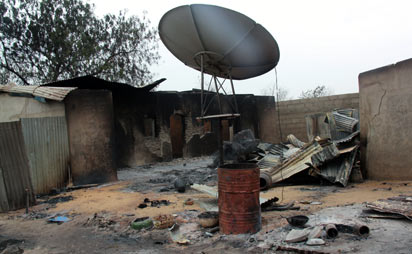 satellite dish sits outside a burnt house in the remote northeast town of Baga on April 21, 2013 after two days of clashes between officers of the Joint Task Force and members of the Islamist sect Boko Haram on April 19 in the town near Lake Chad, 200 kms north of Maiduguri, in Borno State. Photo: AFP.