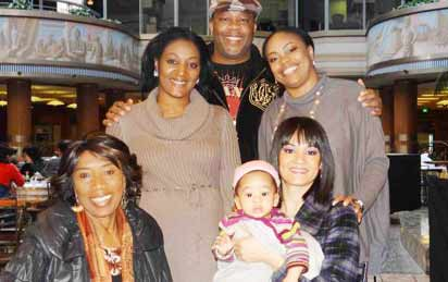 Christy Stallings(1st left) with son, Douglas, wife carrying her grandson and top right, daughter, Delia Eyitemi Stallings