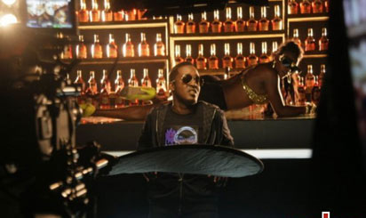 *MI on the set of Bartender a big budget video