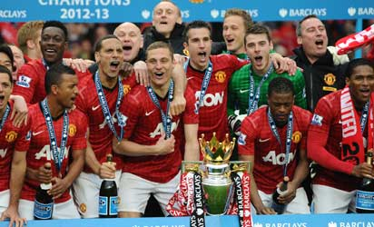 Manchester United players celebrate with the Premier League trophy at the end of the English Premier League football match between Manchester United and Swansea City at Old Trafford in Manchester, northwest England, on May 12, 2013. AFP PHOTO