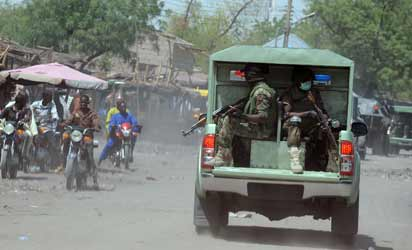 DEPLOYED— File pictures of military patrol and checkpoint in Maiduguri, Borno State. An estimated 3,000 troops have been deployed to embattled states of Borno, Yobe and Adamawa, following the proclamation of State of Emergency in the states on Tuesday. Photos: AFP.