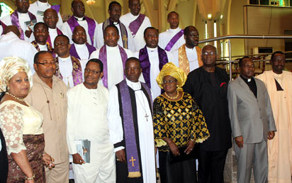 Primate of All Nigeria Anglican Communion, The Most Rev. NIcholas Okoh flanked by Finance MInister, Dr. Ngozi Okonjo-Iweala and Member Achebe Burial Committee, Prof. Uzordinma Nwagi while Information MInister, Mr. Malaran Maku (r); Wife of former Senate President, Senator Magery Chuba-Okadigbo (L); Anambra State Deputy Governor, Mr. Emeka Sibeudu (2L) and Former FCT CAN Chairman, Rev. Williams Okoye (2R) join in a group photograph after the Commendation Service in honour and Memory of Prof. Chinualomogu Achebe at the National Christian Centre, Abuja. Photo: Abayomi Adeshida.