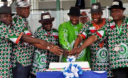 From Left: Chief Emeka Wogu, Comrade Abdulwahed Omar; President Goodluck Jonathan and Comrade Peter Esele cut  anniversary cake at the 2013 May Day Celebration in Abuja on Wednesday