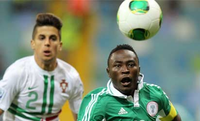 Nigeria's Abdul Ajagun (R) controls the ball during the group stage football match between Nigeria and Portugal at the FIFA Under 20 World Cup at Kadir Has Stadium in Kayseri on June 21, 2013. AFP PHOTO