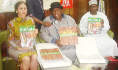 Minister of Tourism, Culture and National Orientation, Chief Edem Duke (middle)  displaying collaterals for  The Brand: Fascinating Nigeria; Beckoning Beauty at the National Theatre, Lagos. With him are the Director Generals of Nigeria Tourism Development Corporation, Mrs. Sally Mbanefo and Alhaji Kabiru.