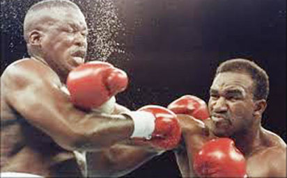 PUNCHY ... Buster Douglas (left) receiving the punch from Evander Holyfield