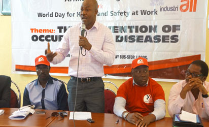 *Oladele Hunsu, President of National Union of Textile, Garment and Tailoring Workers of Nigeria, NUTGTWN, addressing the gathering at the safety seminar while Comrade Lumuba Okugbawa, Deputy General Secretary of Petroleum and Natural Gas Senior Staff Association of Nigeria, PENGASSAN (second from left)  Gbenga Komolafe, General Secretary of Federation of Informal Workers of Nigeria, FIWON, and another labour leader(first from the right), look on.