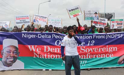 JUNE 12 RALLY: Comrade Rex Anighoro, Spokesman of NDPSF, addressing members of Niger Delta People Salvation Front, NDPSF, during a rally yesterday in Warri in commemoration of the annulled June 12 election. Photo: AKPOKONA OMAFUAIRE.