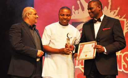 Deepak Srivastava, Chief Operating Officer & Executive Director, Airtel Nigeria; Unyime Idem, Managing Director/CEO of Idems Ultimate Ltd, winner of CEO Award and Best Channel Partner for 2012, receiving his award from Segun Ogunsanya, Managing Director/Chief Executive Officer, Airtel Nigeria, at a Gala Night hosted by Airtel Nigeria for its Channel Partners…on Wednesday