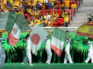 Artists carry the national flags of some of the countries (L-R: Nigeria, Mexico, Japan, Italy and Spain) participating in the FIFA Confederations Cup Brazil 2013, as they perform during the opening ceremony of the football tournament, at the National Stadium in Brasilia on June 15, 2013.    AFP PHOTO / EVARISTO SA