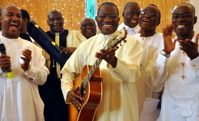President Goodluck Jonathan (4th r) leading other fathers in the presentation of a special song during the 2013 Father's Day celebration at the Aso Villa Chapel Abuja on Sunday (16/6/13).