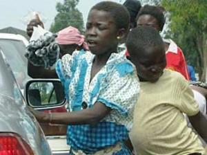 Kids hawking in traffic