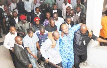 DETAINED—Detained Majority Leader of Rivers State House of Assembly, Chidi Lloyd (M), being assisted to the court in Port Harcourt, Wednesday