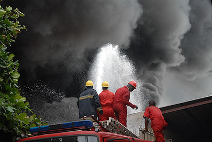 *Fire fighters at Coscharis group company at Kirikiri Industrial estate Mazamaza, Lagos on Thursday,18th of July,2013. Tosin Aladesokun.