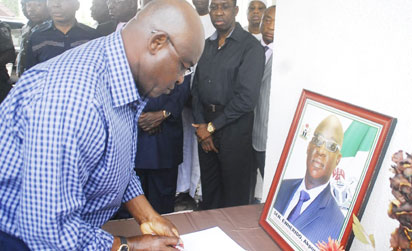Condolence Visit: Senate President, Senator David Mark signing condolence register of Late Senator  Pius  Akpor Ewherido at his residence in Abuja.