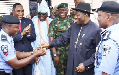 President Jonathan presenting house keys to a beneficiary of of the Goodluck Jonathan Housing Estate, Idimu, Lagosousing Estate giving a salute to guests at the official unveiling of the  Estate on Friday July 19, 2013 in Lagos, watching with admiration are Mr. Olatunde Ayeni, Chairman, ASO Savings & Loans- financier of the Goodluck Jonathan Housing Estate, Idimu, Lagos; Oba of Lagos, Rilwan Akiolu, Lieutenant Colonel Ogogbane Adegbe Aide de Camp to Mr. President, Special Guest of Honour Dr Ebele Jonathan, President, Commander in Chief of Armed Forces of Nigeria and Mr. Muhammed Abubakar, Inspector General of Police at the official unveiling of the 200 of the 504 units of 3-Bedroom block of flats. Photo by Lamidi Bamdiele