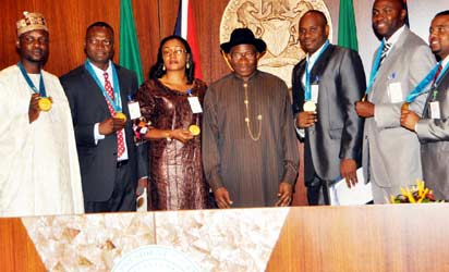 President Goodluck Jonathan (centre) with the 4x4 Men's Relay Team at the 2000 Olympics in Sydney