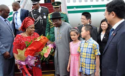 From left President Goodluck Jonathan; First lady, Dame Patince Jonathan being received by the Chinese Assistant Foreign Minister, Mr Le Yucheng on the arrival of the president to Beijin International Airport China for state visit on Tuesday (9/7/13)