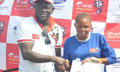 Chairman of YSFON, Lagos Chapter and Former Lagos FA Chairman, Hon. Taiwo Afinni presenting an Airtel goody bag to Lagos Zonal Championship Best Goal Keeper (Female) Ruth Nevo at the just concluded Lagos Zonal Championship at the Legacy Pitch of the National Stadium, Lagos.
