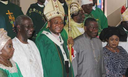 ANENIH @ 80—President Goodluck Jonathan flanked by the First Lady, Dame Patience Jonathan (2r) and Cardinal John Onaiyekan, Chairman PDP Board of Trustees, Chief Tony Anenih and his wife, Mrs. Anenih (l) watch after a Holy Mass celebrated to mark Chief Anenih's 80th birthday at Our Lady Queen of Nigeria, Pro-Cathedral, Area 3, Garki, Abuja, yesterday. Photo: Abayomi Adeshida.