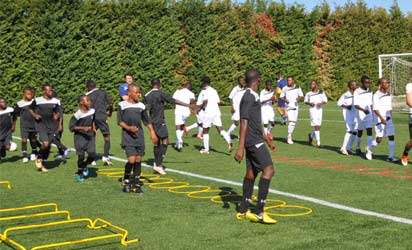 Members of Uplift Football Team in training session at the Bruseschi Centre beside Udinese Stadio Frivli located in Udine in Italy