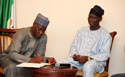 *CONDOLENCE: Kwara State governor, Dr. Abdulfatah Ahmed (left) signing the condolence register of Late Pa Ibrahim Fashola, during a condolence visit to his Lagos State counterpart, Mr. Babatunde Fashola (SAN), at Lagos House, Marina, yesterday.