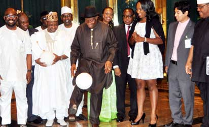 President Goodluck Jonathan (m) juggling the Suckett Football to electricity (a new invention)
