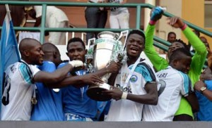 CHAMPIONS... Jubilant Enyimba FC of Aba players celebrate with their trophy after beating Warri Wolves at the Federation Cup final yesterday. in Lagos .