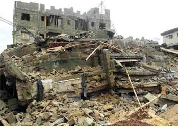 Rubbles of a four-storey building that collapsed at Obanye Street, Onitsha, Anambra State, yesterday. PHOTO: NAN.