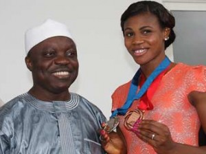 Governor Emmanuel Uduaghan with Blessing Okagbare yesterday
