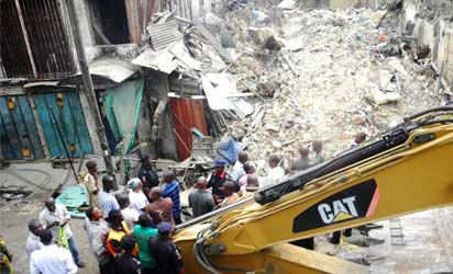 COLLAPSED — A three-storey building at 15 Ali Street, Tinubu, Lagos collapsed, early yesterday, killing two, with six others injured. INSET: Another view of the collapsed building site.