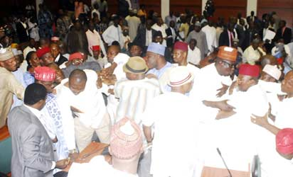 ROWDY REPS—Members of the House of Representatives during the brawl in the House, yesterday. Photos: Gbemiga Olamikan.