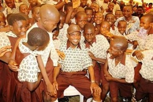 Gov. Aregbesola with students of the O' School Reform initiative.