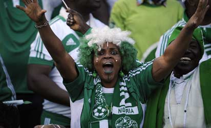 A Nigerian fan celebrates on October 13, 2013 her team's victory over Ethiopia after a 2014 World Cup qualifying match in Addis Ababa.    AFP PHOTO