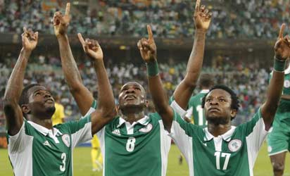 THANK GOD..... Super Eagles players from left, Elderson Echiejile, Emmanuel Emenike and Ogenyi Onazi thanking God after wiining a match. They expect to do same in Addis Ababa tomorrow.